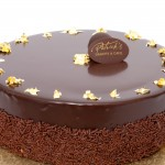 Feullantine Praline Chocolate Cake: Almond spongecake with a hazelnut praline wafer, dark chocolate mousse covered in chocolate ganache
