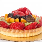 Fruit Tart: Tart shell filled with pastry cream covered with fresh fruit and apricot glaze