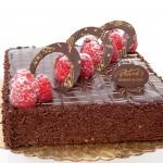 Chocolate Raspberry Cake: Chocolate cake soaked with raspberry syrup and covered with chocolate ganache