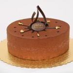 Mandarin Cake: Rice crispy praline base, milk chocolate caramel mousse with a mandarin orange creme brulee