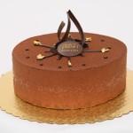 Mandarin Cake: Rice crispy praline base, milk chocolate caramel mousse with a mandarin orange creme brulee