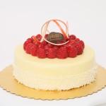 Patrick's Cheesecake: Cheesecake mousse and raspberry jam covered with white chocolate ganache and raspberries